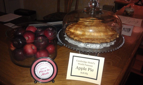 Where you check in, they proudly display apples and pie.