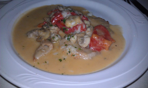 Tender vealmedallionssautéed with roasted peppers andmushrooms, finished with a Marsala wine sauce,topped with asiago, gorgonzola and provolone cheeses