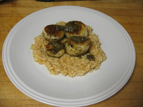 Scallops over risotto