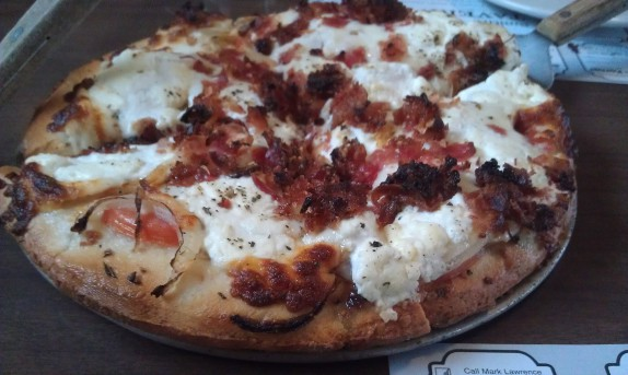 """Roundabout"" (bacon, fresh tomatoes, onions, mozzarella, parmesan and ricotta cheeses, garlic, herbs, and olive oil"