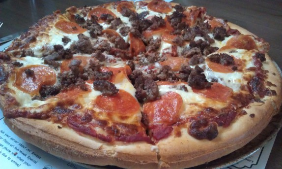 Large pizza with pepperoni and ground beef