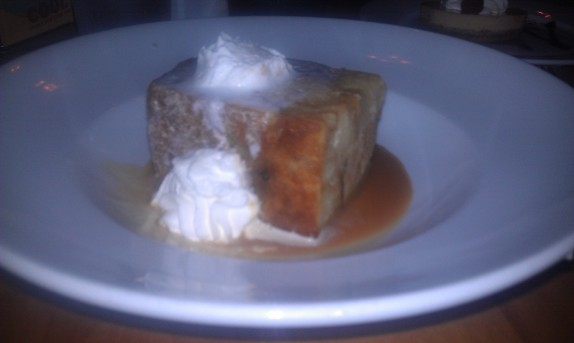 Bourbon Bread Pudding Cooked with bananas and white chocolate, finished with a bourbon caramel sauce topped with fresh whipped cream