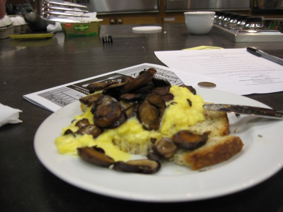 Scrambled eggs with sauteed mushrooms over toast
