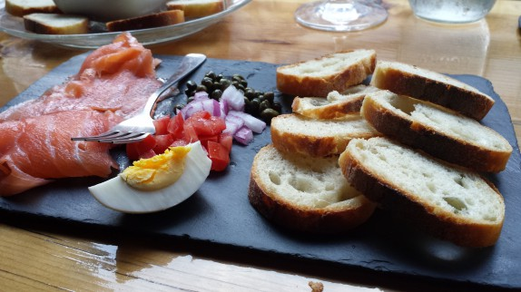 Smoked Salmon │St. James Smokehouse  - 9 Wild Salmon served with capers, tomato, red onion & hard-boiled egg. Served w/ Placid Baker Bread.