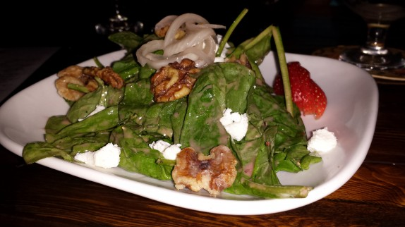 Candied Walnuts, Goat Cheese tossed in our Raspberry Vinaigrette