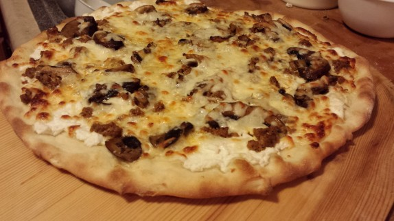Calabrese-Style Pizza topped with fresh spicy sausage and sautéed wild mushrooms