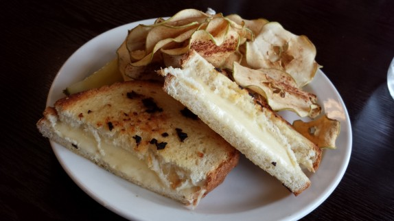 Garlic Rubbed Grilled Cheese Sandwich $9 Roasted garlic oil rubbed homemade bread grilled with creamy whole milk American and smoked mozzarella cheeses