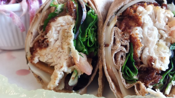Crispy Chipotle Chicken Wrap $10 All natural chicken fried to order chicken breast, local field greens, tomatoes, black olives, smoked mozzarella, balsamic vinaigrette and chipotle mayo on a NY wheat wrap; with potato salad or cole slaw