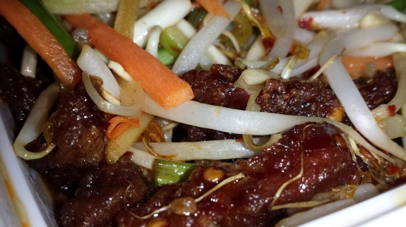 Crispy Shredded Beef in Spicy Sauce $12 - Steak coated in carrot, bean sprouts, celery and scallion batter fried crispy and quickly tossed in a spicy sauce