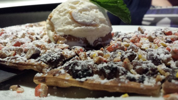 Reeses Peezza flat bread shell topped with chocolate ganache, peanut butter cups, reeses crumbs, peanut butter gelato
