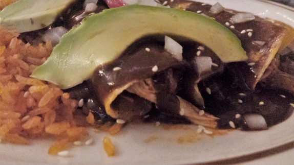 Close up of enchiladas with mole